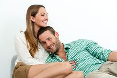 Smiling couple relaxing on couch. Stock Images