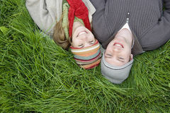Smiling Couple Relaxing On Grass Stock Images