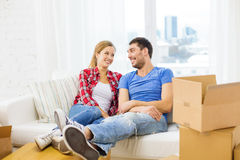 Smiling couple relaxing on sofa in new home Stock Images