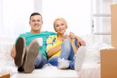 Smiling couple relaxing on sofa in new home Royalty Free Stock Images