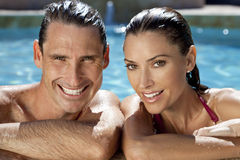 Smiling Couple Relaxing In Swimming Pool Stock Images