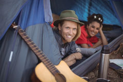 Smiling couple relaxing in tent Stock Images