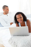 Smiling couple relaxing on their bed Stock Image