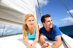 Smiling couple relaxing on a yacht. By sunny day royalty free stock image