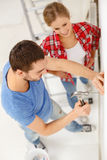 Smiling couple renovating new home Royalty Free Stock Photo