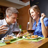 Smiling couple in restaurant Stock Photos