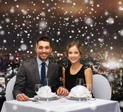 Smiling couple at restaurant Stock Image