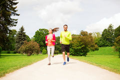 Smiling couple running outdoors Stock Photos