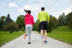 Smiling couple running outdoors Stock Photography