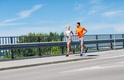 Smiling couple running at summer seaside Stock Photos