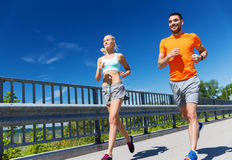 Smiling couple running at summer seaside Stock Photography