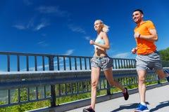 Smiling couple running at summer seaside Royalty Free Stock Image