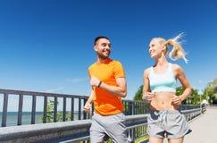 Smiling couple running at summer seaside Stock Image
