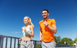 Smiling couple running at summer seaside Royalty Free Stock Photo