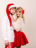 Smiling couple in santa claus hat. Christmas. Royalty Free Stock Photography