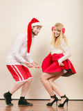 Smiling couple in santa claus hat. Christmas. Royalty Free Stock Photo