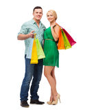 Smiling couple with shopping bags. Happiness, shopping and couple concept - smiling couple with shopping bags Stock Image