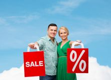Smiling couple with shopping bags Royalty Free Stock Image