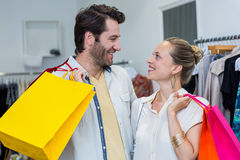 Smiling couple with shopping bags looking at each other Royalty Free Stock Images