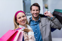 Smiling couple with shopping bags Stock Photos