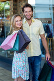 Smiling couple with shopping bags Stock Images