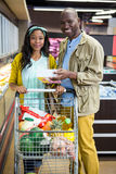 Smiling couple shopping in grocery section at supermarket Stock Images