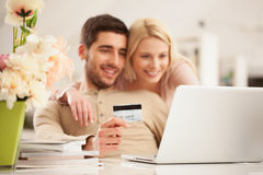 Smiling Couple Shopping Online Royalty Free Stock Photo