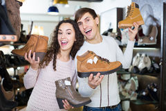 Smiling couple shopping at shoe store Royalty Free Stock Image
