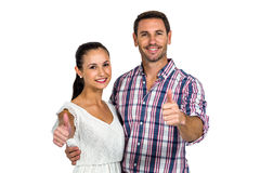 Smiling couple showing thumbs up at camera. On white screen Royalty Free Stock Image