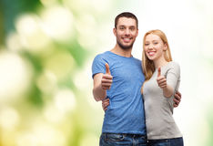 Smiling couple showing thumbs up Stock Images