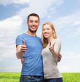 Smiling couple showing thumbs up Stock Photography