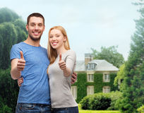 Smiling couple showing thumbs up Stock Photos