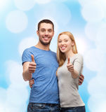 Smiling couple showing thumbs up Royalty Free Stock Image