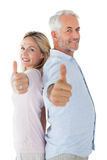 Smiling couple showing thumbs up together Stock Photography