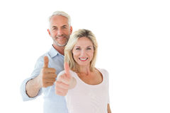 Smiling couple showing thumbs up together Stock Image