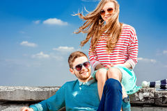 Smiling couple sitting on the roof embracing and smiling on the Royalty Free Stock Photo