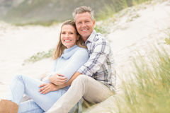 Smiling couple sitting together Stock Photography