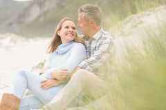 Smiling couple sitting together Stock Photos