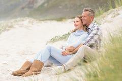 Smiling couple sitting together Stock Image