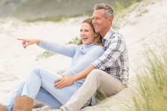Smiling couple sitting together Royalty Free Stock Photos