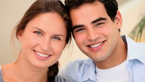 Smiling couple sitting together stock video footage