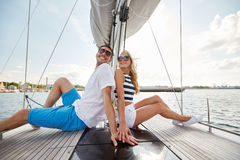 Smiling couple sitting on yacht deck Royalty Free Stock Photo