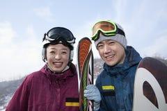 Smiling Couple in Ski Resort Stock Images