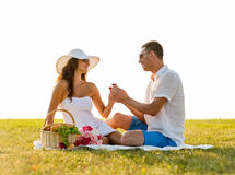 Smiling couple with small red gift box on picnic Stock Photo