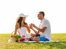 Smiling couple with small red gift box on picnic Royalty Free Stock Photos