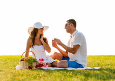 Smiling couple with small red gift box on picnic Stock Photography