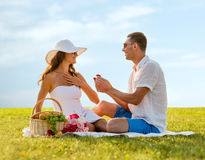Smiling couple with small red gift box on picnic Royalty Free Stock Photography