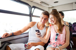 Smiling couple with smartphone making selfie Stock Image