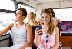 Smiling couple with smartphone making selfie Royalty Free Stock Photo