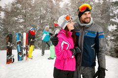 Couple snowboarder enjoying at ski resort in the mountain with f Royalty Free Stock Photo